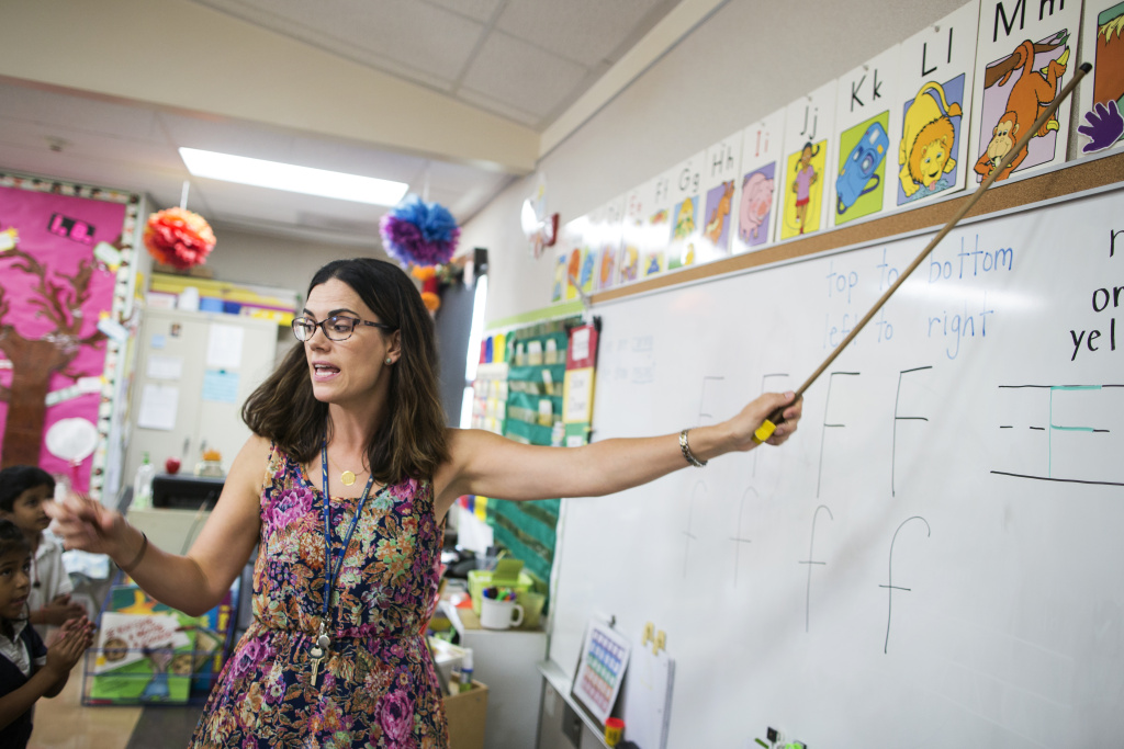 File: Teacher Cherie Wood leads her kindergarten students through an alphabet song at Willard Elementary School in Pasadena, two weeks into the school year, on Wednesday morning, Aug. 31, 2016.
