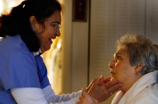 United HomeCare Services home health aide Wendy Cerrato talks with Olga Socarras during a visit on January 6, 2010 in Miami, Florida.