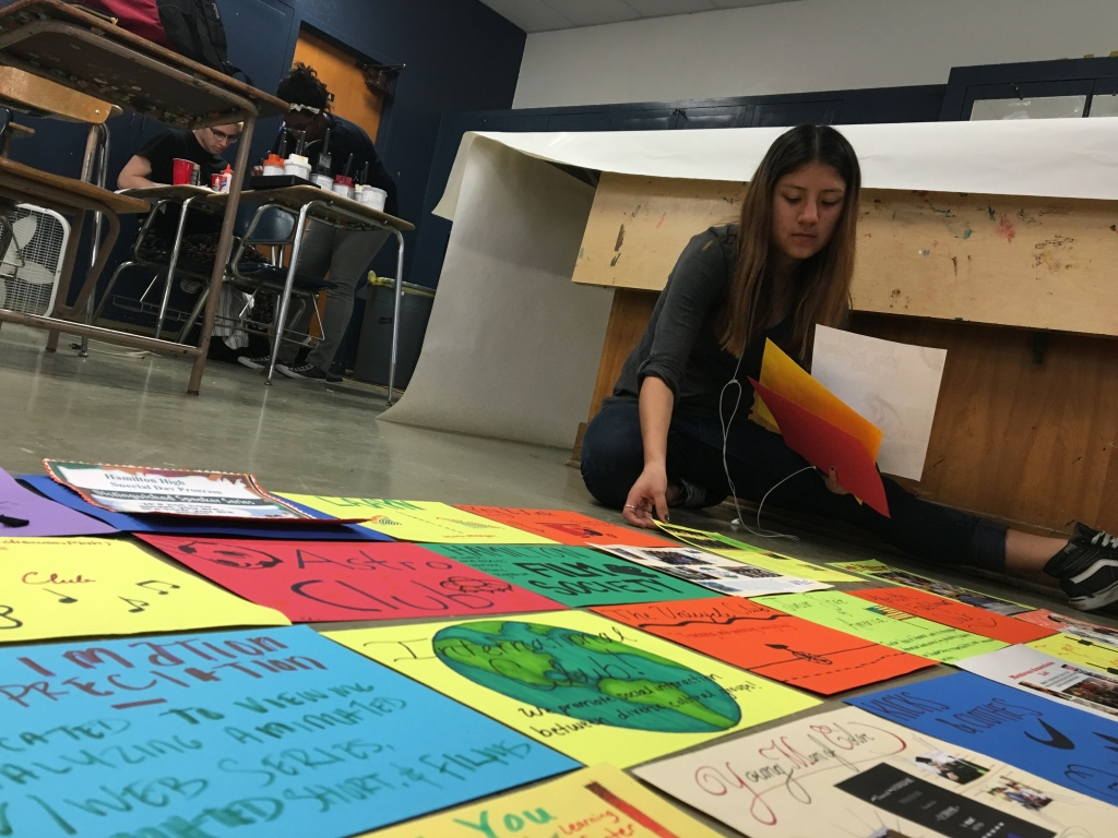"A member of the student government at Hamilton High School in West Los Angeles helps assemble a ""quilt,"" comprised of roughly 100 cardstock panels representing the school's clubs and academic programs, on Friday, Feb. 12, 2016. The quilt will be displayed at a rally at the school on Wednesday, Feb. 17."
