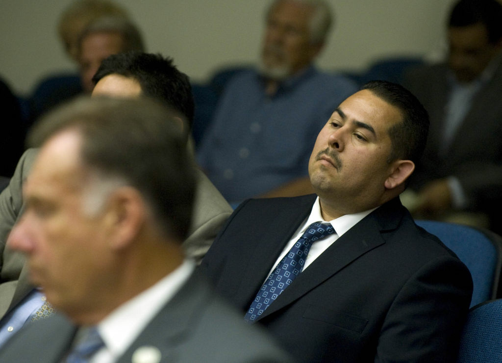 Fullerton police officer Manuel Ramos listens as Judge Walter Schwarm explains why he believes all charges should stand and why he believes Ramos and Fullerton police officer Jay Cicinelli should stand trial for the death of Kelly Thomas.