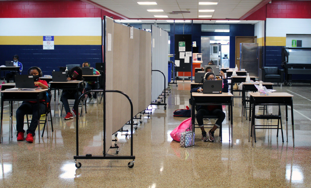A flex wall separates two groups of students in the cafeteria at Dwight D. Eisenhower Charter School in New Orleans.