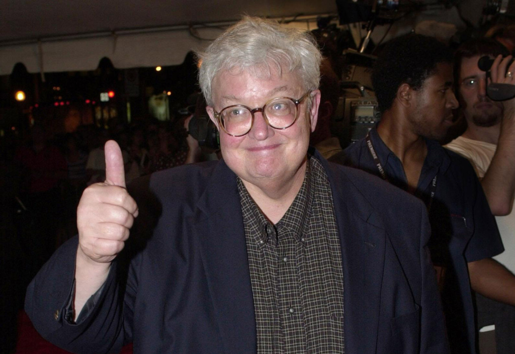 Film critic Roger Ebert gives his trademark thumbs-up as he arrives for the premiere screening of Denzel Washington and Ethan Hawke's new film