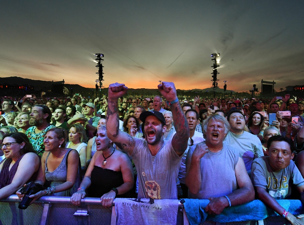 Fans react as they watch The Who perform during the third day of the Desert Trip music festival at Indio, California on October 9, 2016. The Desert Trip weekend will mark what will likely become the highest-grossing music festival of all time as six acts who form rock's canon -- the Rolling Stones, Paul McCartney, Roger Waters, The Who, Bob Dylan and Neil Young -- play in the desert of southern California. / AFP / Mark RALSTON        (Photo credit should read MARK RALSTON/AFP/Getty Images)