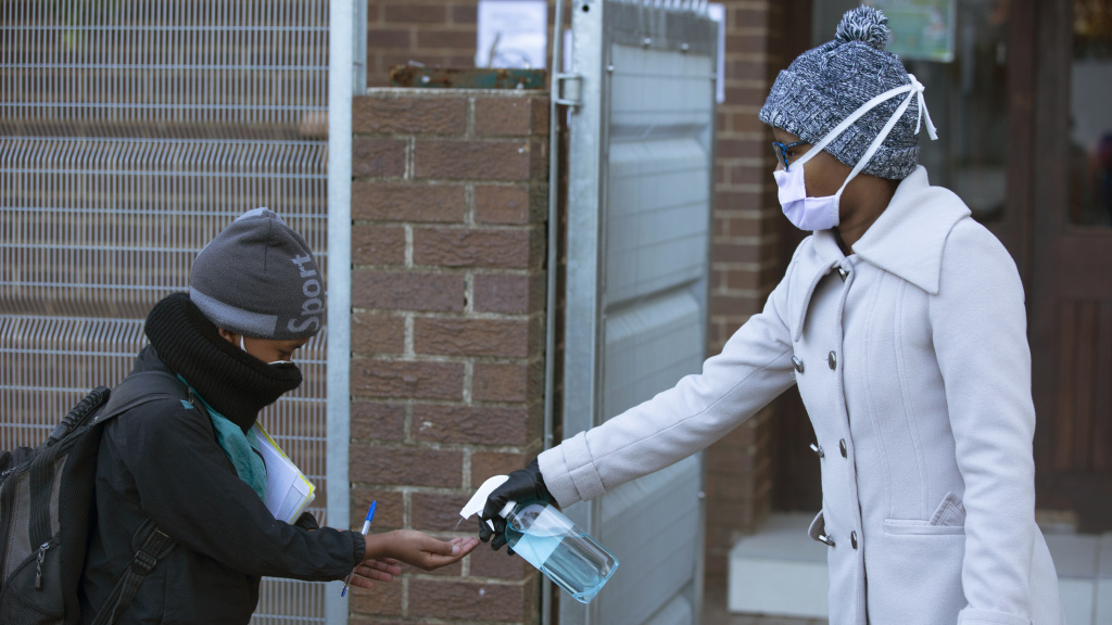 A pupil receives hand sanitizer upon returning to school in Johannesburg on July 6. Since easing its lockdown, coronavirus cases have spiked and the government is introducing some restrictions.
