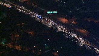 An aerial view of the line of vehicles on the 118 Freeway after a fatal crash on Monday April 1, 2013.
