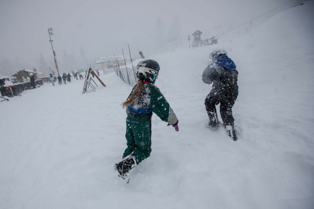 Children have a snowball fight at the foot of Bear Mountain on February 8.