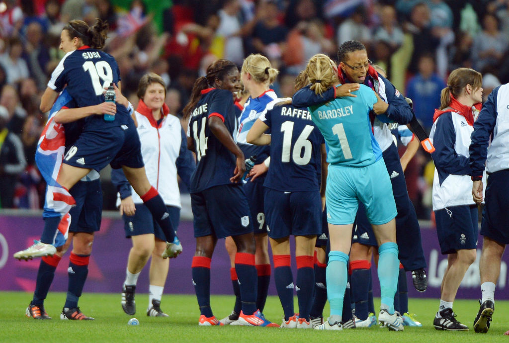 Great Britain's coach Hope Powell (R) celebrates with goalkeeper Karen Bardsley after winning their football match against Brazil during their women's football match at the Wembley Stadium in London, on July 31, 2012 during the London 2012 Olympic Games.