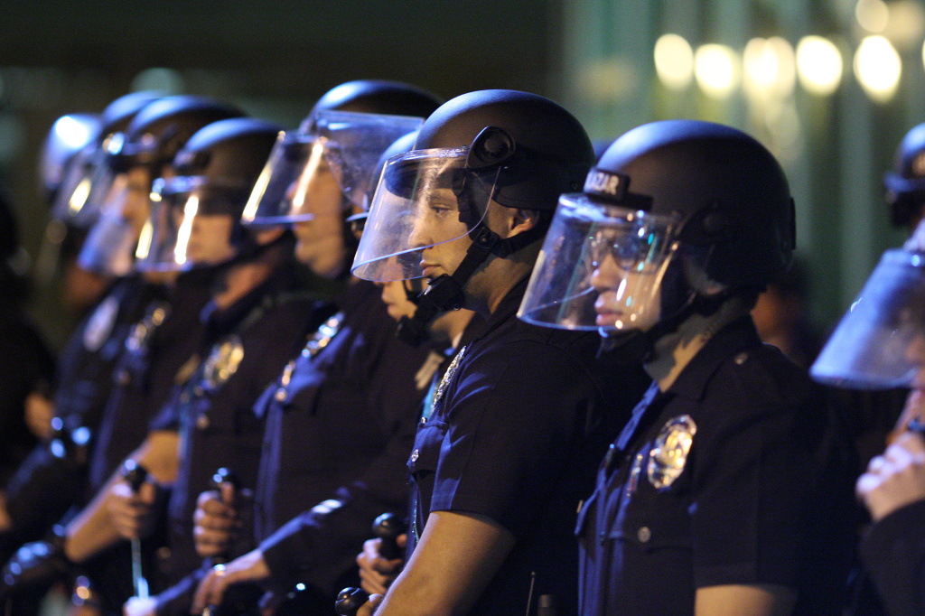 LOS ANGELES, CA - NOVEMBER 25:  Police officers line up to protect the LAPD Headquarters as they face off with protesters after the grand jury decision not to indict a white police officer who had shot dead an unarmed black teenager in Ferguson, Missouri, in the early morning hours of November 25, 2014 in Los Angeles, California. Police officer Darren Wilson shot 18-year-old Michael Brown on August 9, sparking large ongoing protests.  (Photo by David McNew/Getty Images)