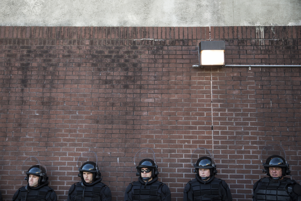 Police officers relax while monitoring the situation near a CVS pharmacy that was looted and burned by rioters on Monday after the funeral of Freddie Gray, on April 29, 2015 in Baltimore, Maryland. When should officers appropriately use profanity?