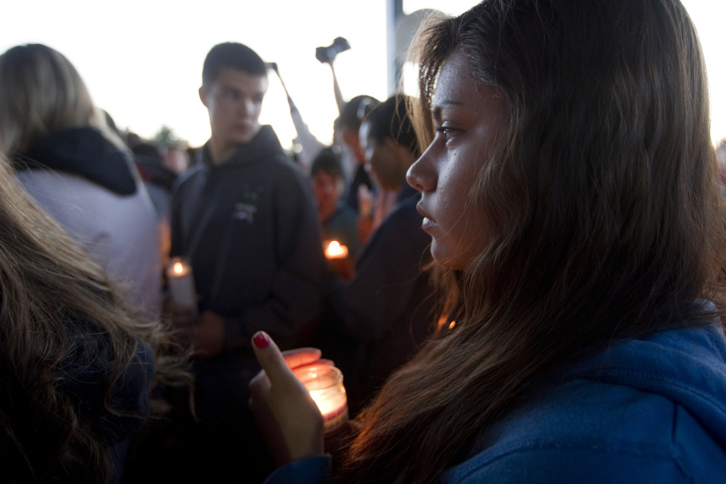 TROUTDALE, OR - JUNE 10:   A student holds a candle for Emilio Hoffman the victim of today's school shooting at a vigil on  June 10, 2014 in Troutdale, Oregon. A gunman walked into Reynolds High School  with a rifle and shot 14 year old Hoffman to death on Tuesday, in what is the the third outbreak of gun violence in a U.S. school in less than three weeks. (Photo by Natalie Behring/Getty Images)