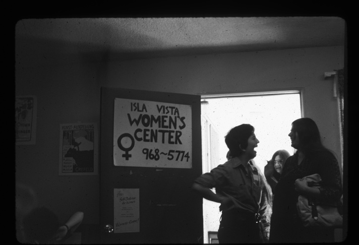 Denise Crippen and Carolyn Weathers with other demonstrators picketting the Gay Community Services Center. May 6, 1975.