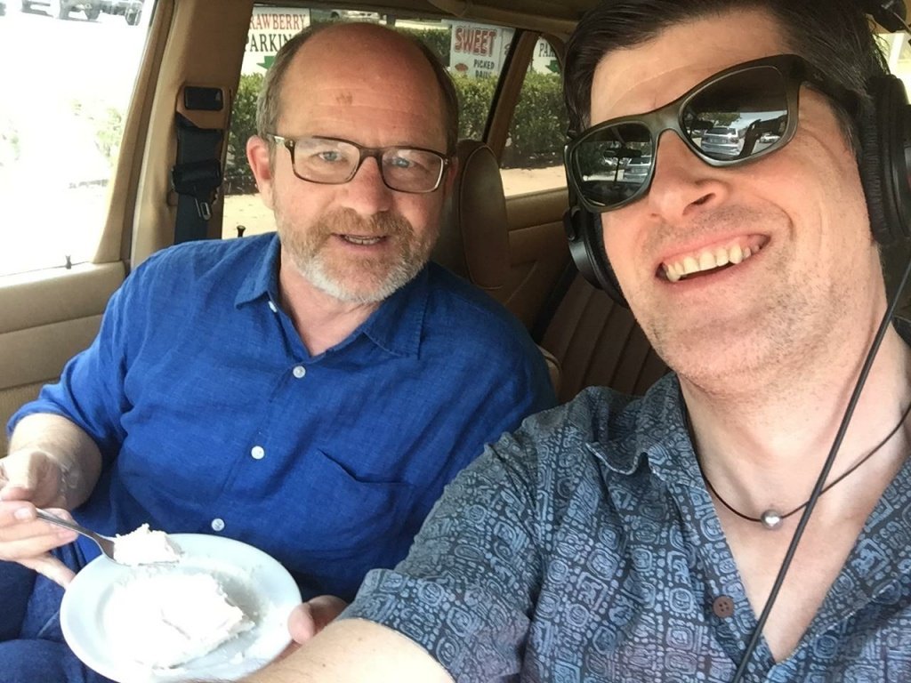 Former LA Times food writer Russ Parsons offers John Rabe a piece of pie, in John's Mercedes