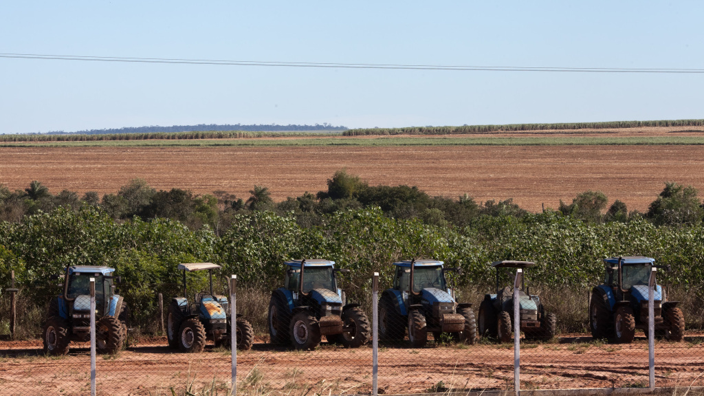 Tractors sit on a sugarcane plantation occupying the  land of a Guarani-kaiowá indigenous community in Brazil.