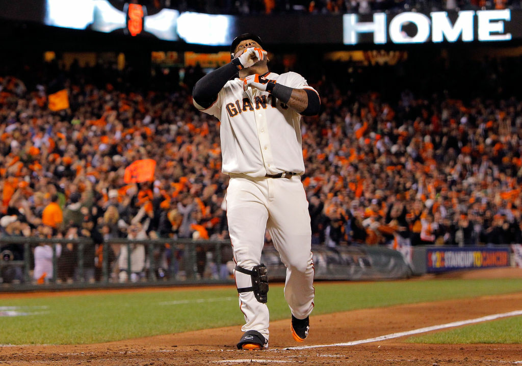 Pablo Sandoval #48 of the San Francisco Giants celebrates after hitting a solo home run to center field against Al Alburquerque #62 of the Detroit Tigers in the fifth inning during Game One of the Major League Baseball World Series at AT&T Park on October 24, 2012 in San Francisco, California.