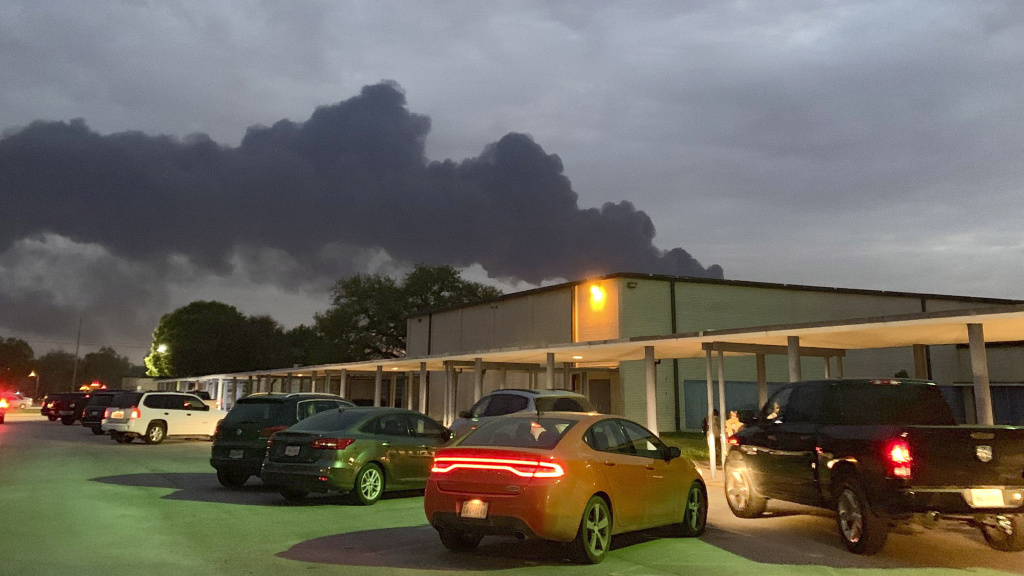 In this photo, taken on Tuesday, smoke rises from a fire at the Intercontinental Terminals Co. near the Carpenter Elementary School in Deer Park, Texas. The blaze briefly reignited on Friday.