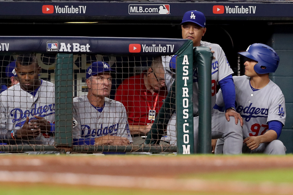 Manager Dave Roberts #30 of the Los Angeles Dodgers looks on from the dugout against the Houston Astros in game five of the 2017 World Series at Minute Maid Park on October 29, 2017 in Houston, Texas.