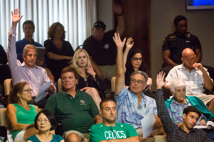 Lifeguard Section Chief Terry Yamamoto holds up a wire leader he thinks was used to try to hook a shark. Public comments took place during a city council meeting at Manhattan Beach City Hall on Tuesday night, July 15. The meeting was the first since a shark attack on the Manhattan Beach Pier on July 5.