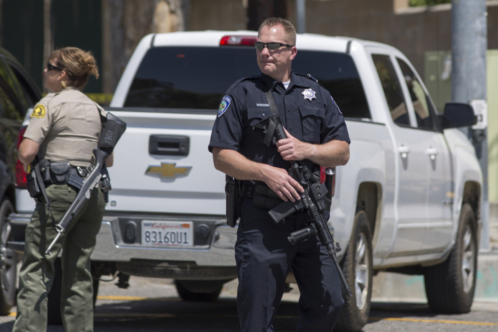 Police offers stand guard at North Park Elementary School following a shooting on campus on April 10, 2017 in San Bernardino, California.