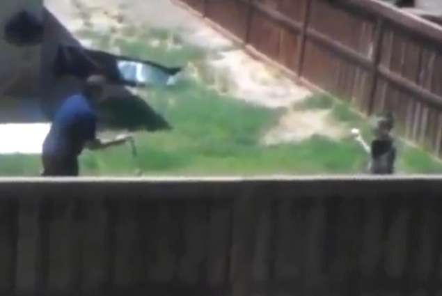 A screen shot of the video taken by neighbor Oscar Lopez showing the alleged incident