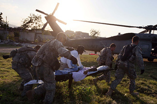U.S. Army soldiers from the 82nd Airborne carry an injured women to an awaiting Navy helicopter as they medivac her after she was injured during the earthquake to the USNS Comfort on January 23, 2010 in Port-au-Prince, Haiti. Supplies and medical help continue to arrive as governments and aid agencies launch the massive relief operation after a powerful earthquake killed tens of thousands.